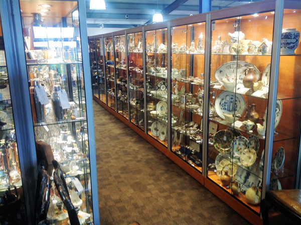 Cabinets full of antiques and collectables
