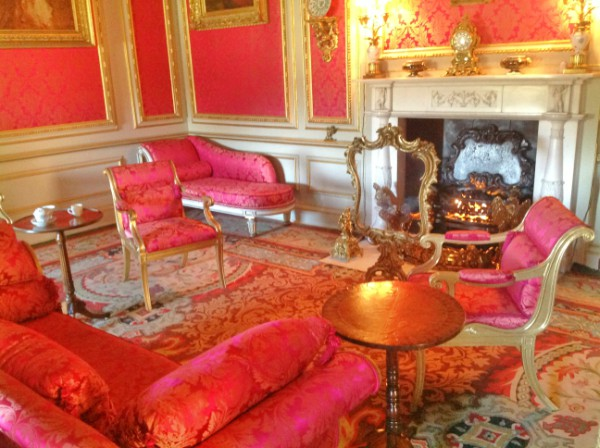 The calm Red Drawing Room at Belton House